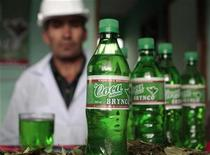 """<p>Johnny Vargas, creator of a new soda drink called """"Coca Brynco"""" by Soda Pacena, looks at bottles of the beverage in the company's bottling plant in El Alto, in the outskirts of La Paz January 17, 2011. """"Coca Brynco"""" is the private soda company's new soft drink made with extracts of coca leaves. REUTERS/David Mercado</p>"""