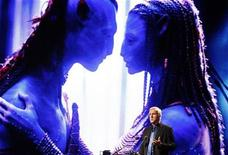 "<p>Film director and Lightstorm Entertainment Chairman James Cameron delivers a keynote address titled ""Renaissance now in imagination and technology"" in front of an image of his recent movie ""Avatar"" during the Seoul Digital Forum 2010 May 13, 2010. REUTERS/Jo Yong-Hak</p>"