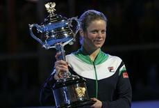 <p>A belga Kim Clijsters derrotou a chinesa Li Na e conquistou o Aberto da Austrália pela primeira vez. REUTERS/Petar Kujundzic</p>