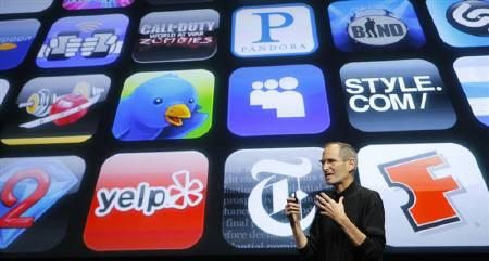 Apple Inc. CEO Steve Jobs speaks in front of the display showing buttons of various apps during the iPhone OS4 special event at Apple headquarters in Cupertino, California April 8, 2010. REUTERS/Robert Galbraith/Files