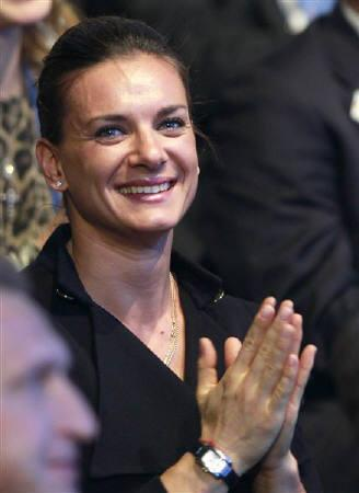 File photo of pole vaulter Yelena Isinbayeva as she reacts after the announcement that Russia is going to be host nation for the FIFA World Cup 2018, in Zurich December 2, 2010. REUTERS/Francois Lenoir/Files
