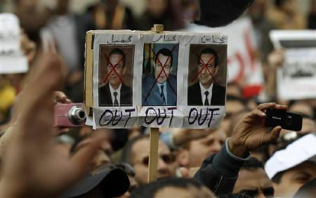 Pictures of Egypt's President Hosni Mubarak are seen during mass demonstrations against Mubarak in Alexandria February 4, 2011. REUTERS/Dylan Martinez