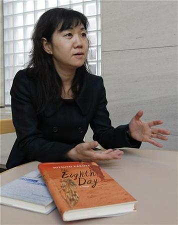 Author Mitsuyo Kakuta speaks during an interview with Reuters in Tokyo January 24, 2011. REUTERS/Kim Kyung-Hoon