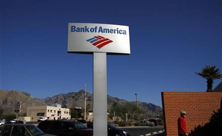 A customer walks past a Bank of America sign outside a branch in Tucson, Arizona January 21, 2011. REUTERS/Joshua Lott