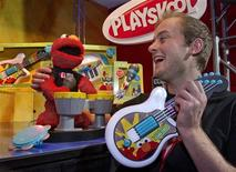 "<p>Tom Worthington, from Hampshire, England, demonstrates the new ""Let's Rock Elmo"" at the unveiling of the new Sesame Street branded line of Playskool products at Hasbro's American International Toy Fair showroom in New York, February 12, 2011. REUTERS/Ray Stubblebine/Hasbro/Handout</p>"