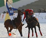 <p>Pierre Henri (L) of France fights for the ball against John Fisher of Hong Kong during their match of Asia Snow Polo Tournament at Tianjin Goldin Metropolitan Polo Club in Tianjin municipality February 15, 2011. REUTERS/Petar Kujundzic</p>