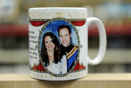 A souvenir mug on sale to mark the forthcoming wedding of Britain's Prince William and Catherine Middleton is seen at a shop in London, January 27, 2011. A Mexican teenager is staging a hunger strike outside the British Embassy in Mexico City in a bid to secure an invitation to the royal wedding of William and Middleton. REUTERS/Paul Hackett/Files