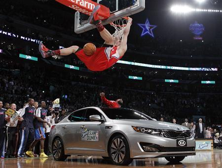 Los Angeles Clippers Blake Griffin Hangs On The Rim After Jumping Over A Car While Competing In Slam Dunk Contest During Nba All Star