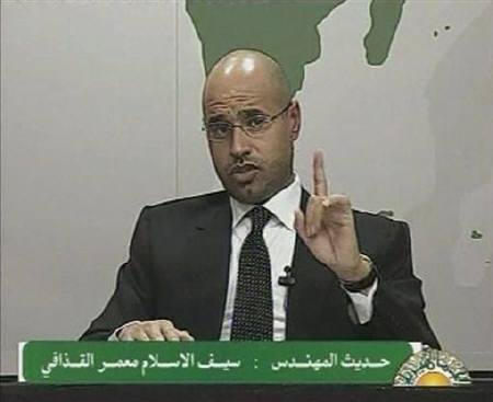 Saif al-Islam, son of Libyan leader Muammar Gaddafi, gestures as he speaks during an address on state television in Tripoli, in this still image taken from video, February 20, 2011. REUTERS/Libyan TV via REUTERS TV