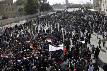 Residents demonstrate in central Baghdad February 25, 2011.  REUTERS/Saad Shalash/Files