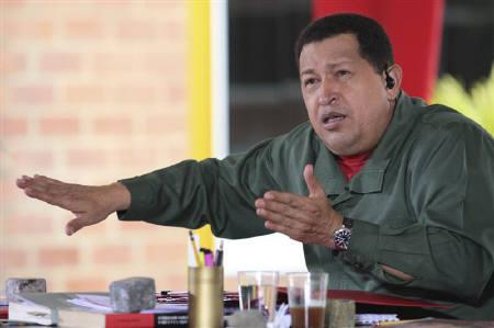 Venezuela's President Hugo Chavez speaks during his weekly broadcast ''Hello President'' outside Caracas February 13, 2011. REUTERS/Miraflores Palace/Handout