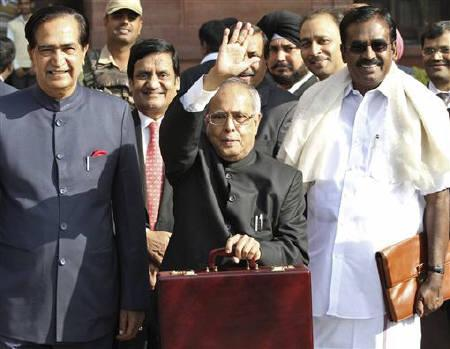 Finance Minister Pranab Mukherjee waves as he leaves his office to present the budget in New Delhi February 28, 2011. REUTERS/Vijay Mathur