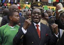 """<p>Zimbabwean President Robert Mugabe arrives for the """"Bob 87 Super Cup"""" a soccer match between local teams Dynamos and Caps United in Harare, February 27, 2011. REUTERS/Philimon Bulawayo</p>"""