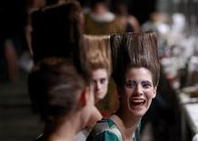 <p>A model laughs while talking to other models backstage before the Varanasi 2011 Fall/Winter collection show during Buenos Aires Fashion Week, February 22, 2011. REUTERS/Marcos Brindicci</p>