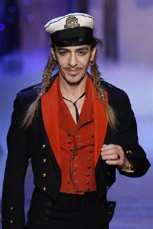 British designer John Galliano for French fashion house Dior appears at the end of his Spring/Summer 2011 women's collection during Paris Fashion Week October 1, 2010. REUTERS/Benoit Tessier/Files