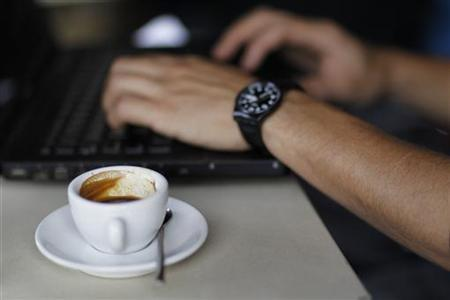 A patron uses his laptop while having an espresso at the Silver lake location of Intelligentsia Coffee and Tea in the Silver Lake area of Los Angeles October 19, 2010. REUTERS/Mario Anzuoni