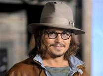 """<p>Cast member Johnny Depp, who voices the titular character """"Rango"""", arrives at the premiere of the animated film in Los Angeles, California February 14, 2011. REUTERS/Gus Ruelas</p>"""