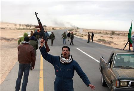Anti-Gaddafi rebels react as they retreat after coming under rocket fire during clashes with pro-Gaddafi forces near Ras Lanuf March 8, 2011. REUTERS/Asmaa Waguih