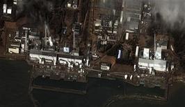 """<p>Спутниковый снимок атомной электростанции """"Фукусима-1"""" в Японии 16 марта 2011 года. Аварийная атомная электростанция """"Фукусима-1"""", оказавшаяся в центре японского ядерного кризиса, имеет шесть реакторов. REUTERS/DigitalGlobe/Handout</p>"""