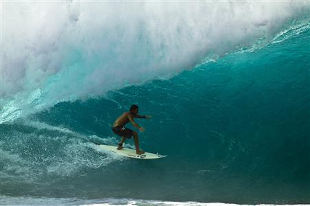 Sion Milosky, 35, of Kalaheo, Kauai, Hawaii, is shown surfing the Pipeline in this November 15, 2010 photograph provided by Volcom, one of Milosky's sponsors. REUTERS/Andrew Christie/Volcom/Handout