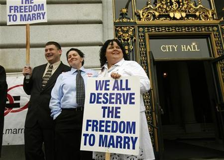Same sex couple Terese Rowe (C) and Kristin Orbin wait to receive a marriage license application prior to a judge lifting the Proposition 8 stay on same sex marriages at City Hall in San Francisco, California August 12, 2010. REUTERS/Robert Galbraith