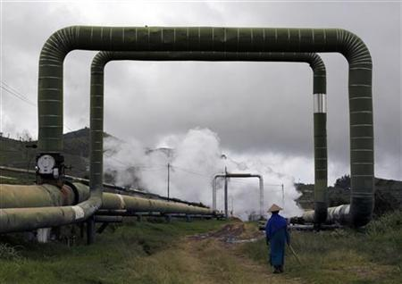 A villager walks under a pipeline at Dipa Energi's Geothermal Power Plant (PLTP) project at Dieng mountain area, Central Java province October 3, 2010. Japan is sitting on enough untapped geothermal power to replace all its planned nuclear stations over the next decade. REUTERS/Beawiharta