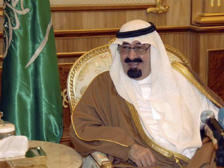 Saudi King Abdullah smiles in his palace in Riyadh February 14, 2009.  REUTERS/Saudi Press Agency/Handout/Files
