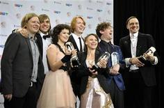 <p>Members of the band Arcade Fire pose with their four awards during the 40th Juno Awards in Toronto March 27, 2011. REUTERS/Mike Cassese</p>