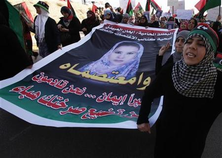 Women hold a picture of Eman al-Obaidi during a protest in Benghazi March 27, 2011. REUTERS/Suhaib Salem