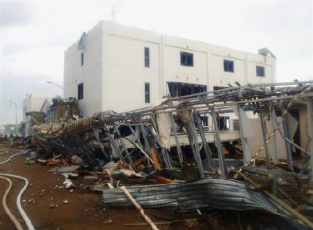 A handout photo from Japan's Nuclear and Industrial Safety Agency shows damage to the new service building at Tokyo Electric Power Co.'s Fukushima Daiichi Nuclear Power Plant in Tomioka, Fukushima Prefecture northeastern Japan March 23, 2011. REUTERS/Nuclear and Industrial Safety Agency via Kyodo/Handout