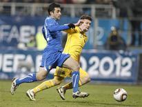 <p>O italiano Giuseppe Rossi (à esq.) desafia o ucraniano Artem Fedetskiy durante amistoso no estádio Valeriy Lobanovskiy, em Kiev. 29/03/2011 REUTERS/Gleb Garanich</p>