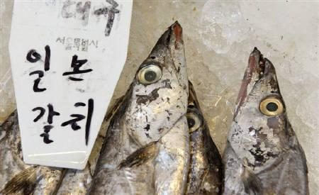 Cutlassfishes imported from Japan displayed at a shop in Garak-dong agricultural and marine products market in Seoul March 29, 2011. REUTERS/Jo Yong-Hak