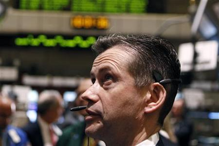 A trader works on the floor of the New York Stock Exchange while waiting for the Initial Public Offering (IPO) of shares in the company Apollo Global Management in New York March 30, 2011. REUTERS/Lucas Jackson