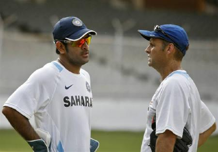 File photo of India's captain Mahendra Singh Dhoni (L) as he talks with coach Gary Kirsten during a practice session  in Ahmedabad November 1, 2010. REUTERS/Amit Dave/Files