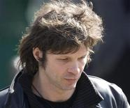 <p>French singer Bertrand Cantat leaves after funeral services for late French singer Alain Bashung at the Saint-Germain-des-Pres church in Paris March 20, 2009. REUTERS/Charles Platiau</p>