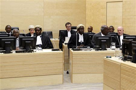 Kenya's Finance Minister Uhuru Kenyatta (L, back row), Cabinet Secretary Francis Muthaura (2nd L, front row), and former police chief Hussein Ali appear (2nd R, front row) at the International Criminal Court in The Hague April 8, 2011. Kenyatta and two other officials appeared on Friday at the International Criminal Court to hear charges of murder, forcible transfer, rape and persecution. REUTERS/Bas Czerwinski/Pool
