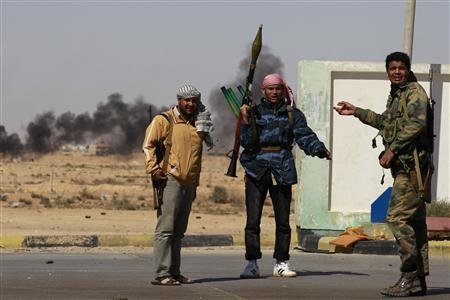 Rebel fighters take position on the frontline in Ajdabiyah April 10, 2011. REUTERS/Youssef Boudlal