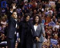 <p>Democratic presidential candidate U.S. Senator Barack Obama (D-IL) (L), his wife Michelle (C) and talk show host Oprah Winfrey wave to the crowd at a campaign rally in Manchester, New Hampshire December 9, 2007. REUTERS/Brian Snyder</p>