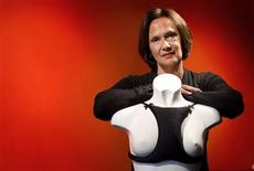 "<p>Rachel de Boer poses with her anti-wrinkle bra, ""La Decollette"", at a lingerie shop in Amsterdam April 14, 2011. REUTERS/Jerry Lampen</p>"