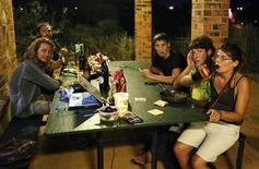 "<p>Pic Segolene, a 25-year-old French backpacker, enjoys a beer with her friends at the community centre in Karratha April 18, 2011. Demand for Australian commodities is running white-hot. So too are costs in the country's remote mining towns, to the point where tiny huts or ""dongas"" can cost as much as a five-star hotel room and backpackers can earn $2,000 a week cleaning them. REUTERS/Daniel Munoz</p>"