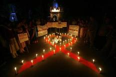 <p>Activists from a non-governmental organisation (NGO) light candles during an AIDS awareness campaign ahead of World AIDS Day in Agartala, capital of India's northeastern state of Tripura November 30, 2010. REUTERS/Jayanta Dey</p>