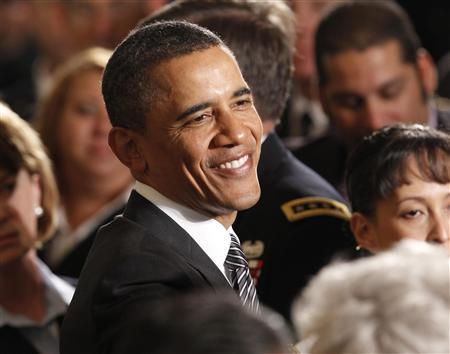 President Barack Obama smiles as he greets members of the audience following a ceremony held to posthumously award Private First Class Anthony T. Kaho'ohanohano, U.S. Army, and Private First Class Henry Svehla, U.S. Army, the Medal of Honor for conspicuous gallantry at the White House, in Washington May 2, 2011. REUTERS/Kevin Lamarque