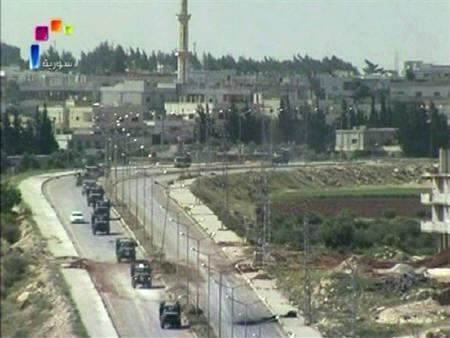 Syrian military vehicles leave Deraa May 5, 2011 in this still image taken from video. REUTERS/Syrian TV via Reuters TV