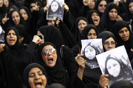 A family member of Bahiya al-Aradi, a woman who was killed during riots, shouts anti-government slogans during her funeral procession held in Manama March 22, 2011. REUTERS/Hamad I Mohammed/Files
