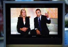 "<p>Meredith Vieira (L) and co-host Matt Lauer are seen here on a monitor during the opening of the show on her first day on NBC's ""Today"" in New York September 13, 2006. REUTERS/Brendan McDermid</p>"