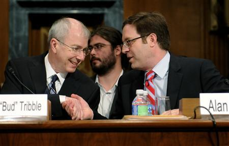 Apple Vice President of Software Technology Guy ''Bud'' Tribble (L) shakes hands with Google Director of Public Policy Alan Davidson (R) as they take their seats for a Senate Judiciary Committee hearing titled ''Protecting Mobile Privacy: Your Smartphones, Tablets, Cell Phones and Your Privacy'' on Capitol Hill in Washington May 10, 2011. REUTERS/Jonathan Ernst
