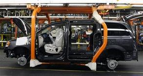 <p>A partially assembled Chrysler minivan works its way down the assembly line during the production launch of the new 2011 Dodge Grand Caravan's and Chrysler Town & Country minivans at the Windsor Assembly Plant in Windsor, Ontario January 18, 2011.REUTERS/Rebecca Cook</p>