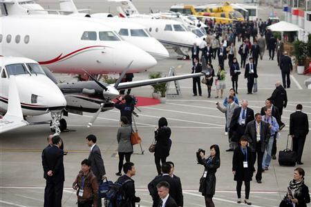People attend the Shanghai International Business Aviation Show at the Hongqiao International Airport in Shanghai April 13, 2011. REUTERS/Carlos Barria