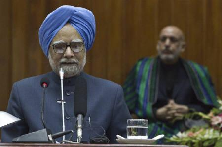 India's Prime Minister Manmohan Singh (L) addresses a joint session of the Afghan parliament as Afghan President Hamid Karzai watches at the parliament house in Kabul May 13, 2011. REUTERS/Ahmad Masood