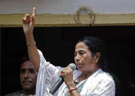 Trinamool Congress party leader Mamata Banerjee gestures outside her home in Kolkata, May 13, 2011. REUTERS/Danish Siddiqui